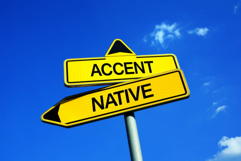 road signs labeled 'accent' and 'native' are pointing away from each other