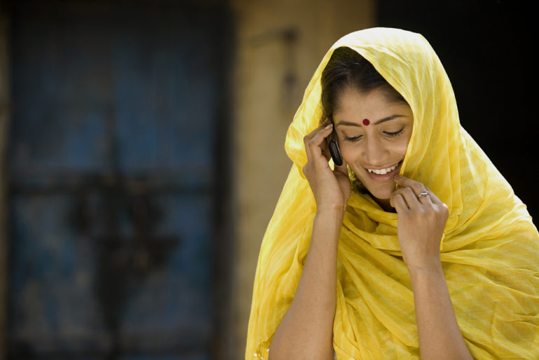 An Indian woman talking on the phone - language strategy