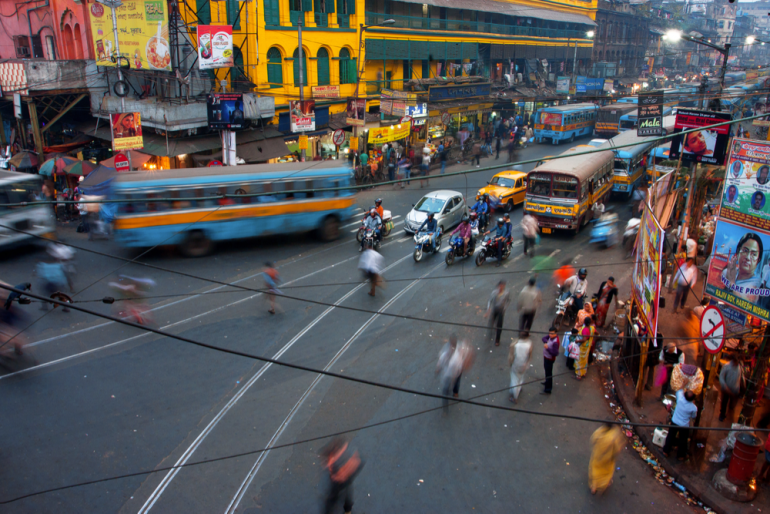 Street traffic blurred in motion at evening in Kolkata, India