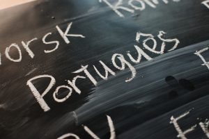 Chalk board with Portuges written on it