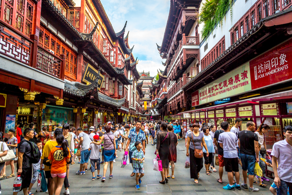 Shanghai, China - July 21st. 2016 - Local and tourists enjoying a warm summer day in downtown Shanghai in China, Asia.