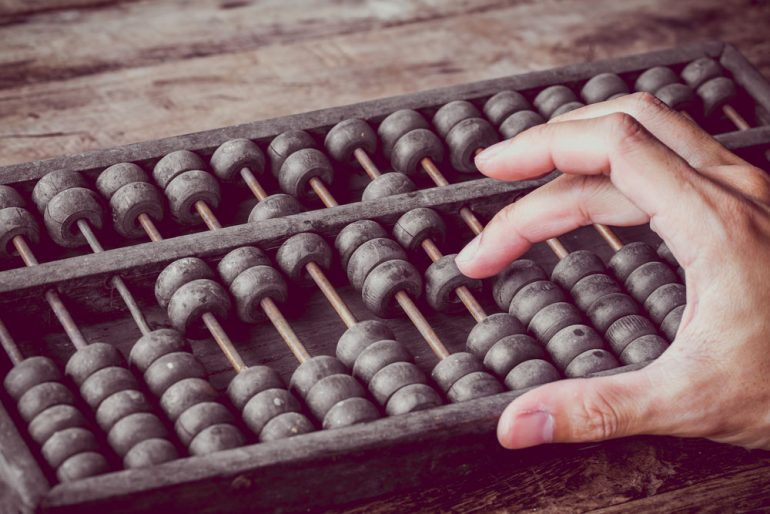 Man using an abacus
