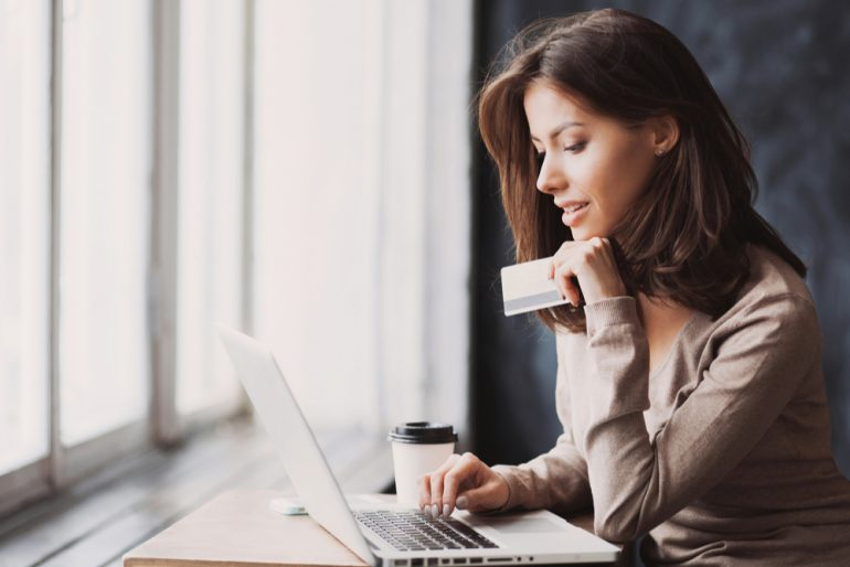 Woman buying goods online using her credit card