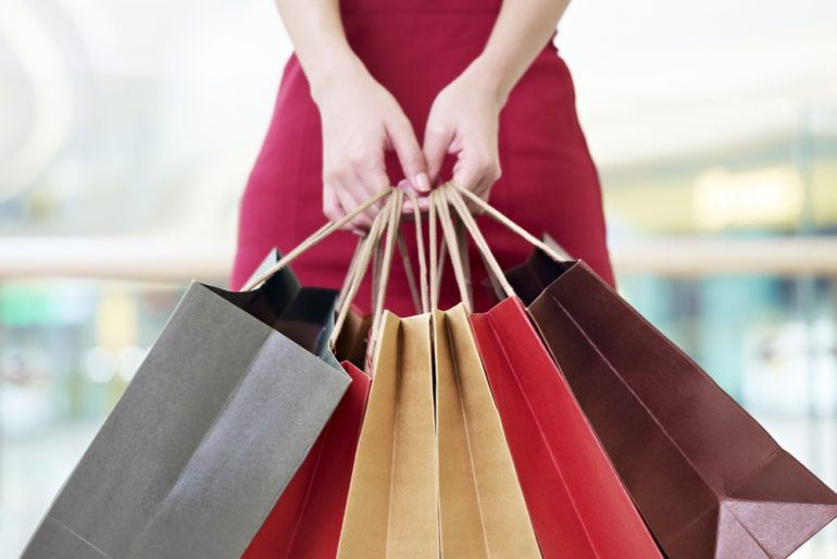 Woman holding bags of shopping