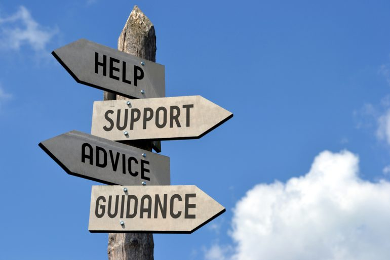 Wooden signposts with help, support, advice and guidance written on them