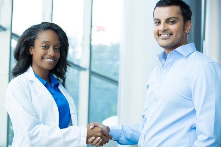 Doctor shaking hands with a patient during a clinical trial
