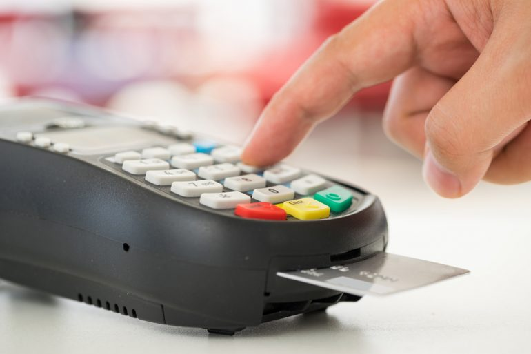 Credit card payment machine being used by a custoemr