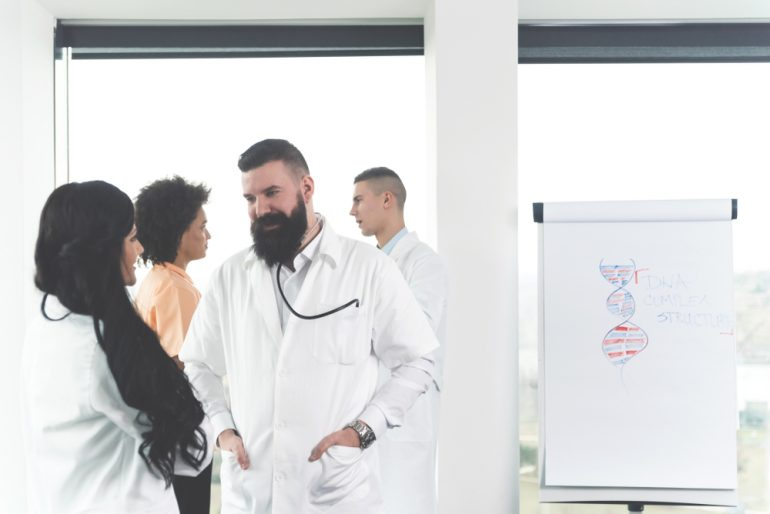 Doctors talking to each other during a clinical trial