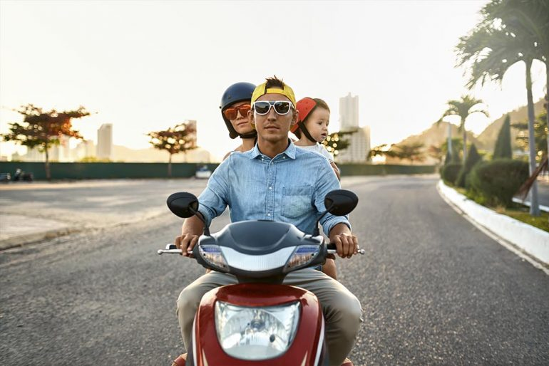 Family riding on a motorbike