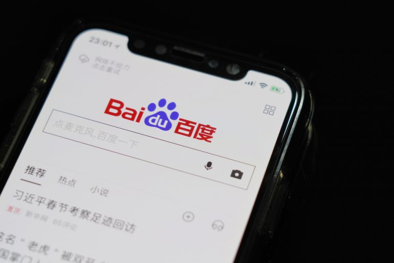 Mobile phone with whe Baidu app open on its screen