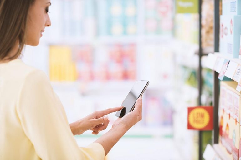 Woman on her phone using augmented reality to shop for goods