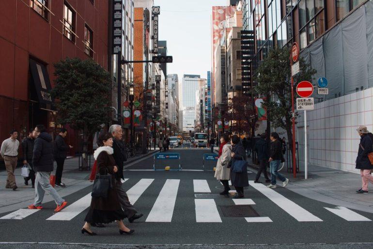 People in Tokyo, Japan crossing the road