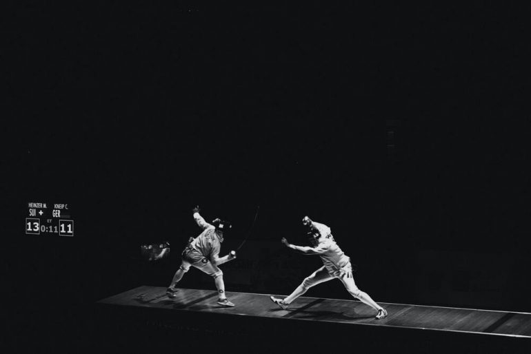 Black and white image of an Olympic fencing match