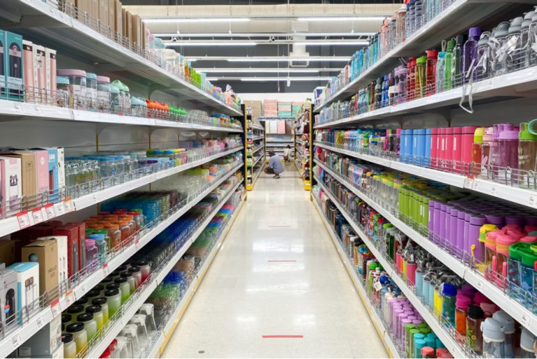 Consumer products are placed on the shelves at a large supermarket