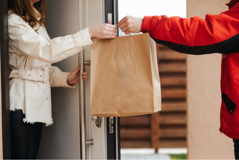 Take away food delivery being delivered to a customer