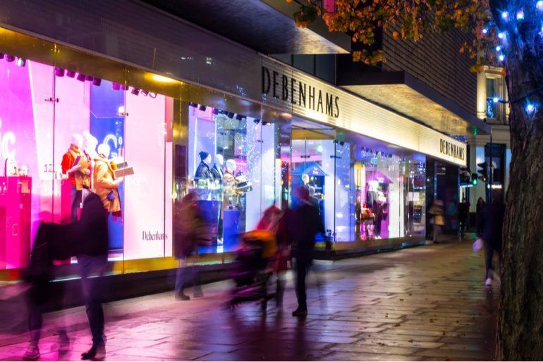 Debenhams illuminated shop window on Oxford Street at night